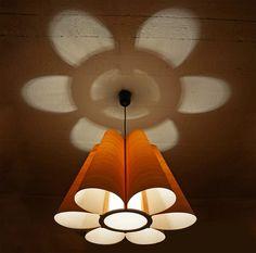 Looking for a small pendant with a nice flower-shape pattern on the ceiling ? We have added the following light to our collection with a dia of 60cm x H 40 cm made of maple wood, other wood is possible upon request.