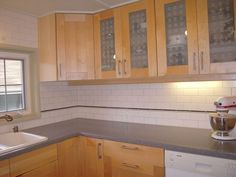 kitchen with subway tile backsplash and oak cabinets - Google Search: