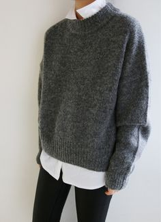 You cannot go wrong with a combination of black, grey and white! This is another great pairing of a chunky grey sweater and a white button-down shirt.