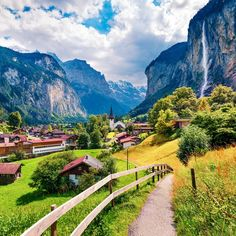 Lauterbrunnen, Switzerland, is straight out of a storybook. The small village of fewer than residents is tucked away in a lush green valley textured with trees and wildflowers. The valley is … Tolkien, Mountain Love, Largest Waterfall, Green Valley, Wanderlust, Swiss Alps, Beautiful Places To Travel, Future Travel, Dream Vacations