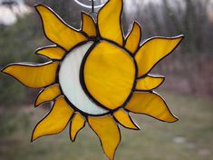 This is a really cool sun and moon suncatcher. The piece is made using a beautiful yellow swirl glass combined with an iridescent white cloud glass for the moon. The piece measures 6 high by 6 wide. All of my pieces are done in the Tiffany Method of stained glass. Glass is cut, #StainedGlassMoon