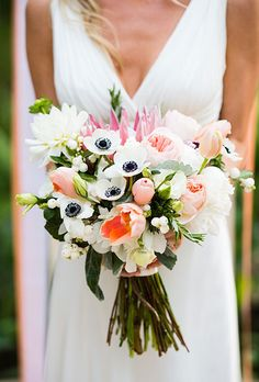 Modern Bouquet with Protea, Tulip, and Anemones | Brides.com