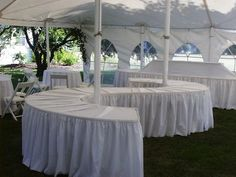 Serpentine Tables Are Great For Buffets. We Love How This Client Utilized  Their Space By Wrapping It Around The Tent Poles.