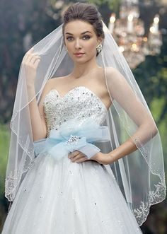 Cinderella Veil, Style 118- Single-tier, fingertip length veil adorned with metallic embroidery, crystal beading and rhinestones (with Cinderella at the Ball gown, Style 241)