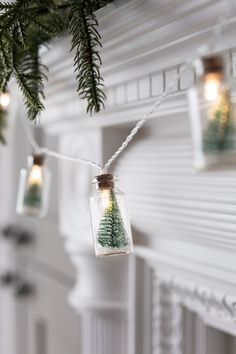Our little bottles have eternally captured a winter wonderland within. Each of the 10 glass jars houses a snow dusted tree and a warm white bulb giving a subtle glow. Drape over mirrors, use as a table centrepiece and at just over 5cm tall, they make the perfect gift.