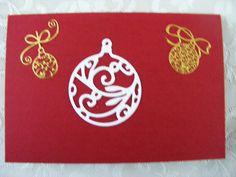 dubbele rode kaart voorkant met stans(kerstbal) en stickers
