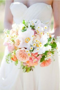 Inspiration for the bridal bouquet, with a touch of orange added in a few more wispy textures.