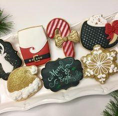 I think these are my favorite Christmas cookies ever! Or maybe I'm just thrilled to post some I actually made this year! I'm posting a couple of close ups too! #christmascookies #blackandwhitechristmas #candycanecookies #reindeercookies #santacookies #stockingcookies #hotcocoacookies #hotchocolatecookies #coffeemugcookies #coffeecookies #goldchristmascookies #sparkle