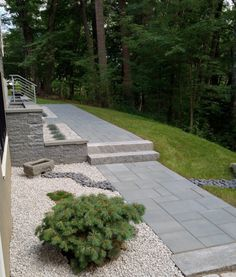 """This gorgeous Massachusetts Patio was created by Natural Path Landscaping using:  Pavingstones: Ledgestone XL  Wall: 3"""""""" Bluestone Blend"""