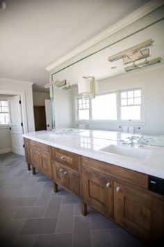 dark grey floors + cherry shaker cabinets + white/glass top