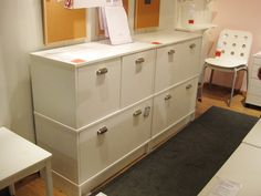Ikea effectiv system - this configuration would be perfect in my office on that blank wall. Making both bottom cabinets file drawers gives us plenty of room to grow.