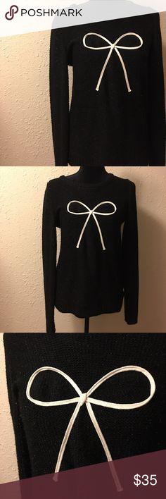 Gorgeous Metallic Black Bow Sweater Very stretchy and warm! In like new condition. Has really pretty metallic flecks of color in the black. Slightly loose fitting but still has shape! Perfect for holiday parties! LC Lauren Conrad Sweaters Crew & Scoop Necks
