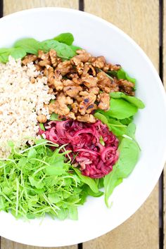 Delicious seasonal feijoa recipe, a savoury way to use feijoas in a salad, with caramelised walnuts, brown rice, caramelised red onions, grounding brown rice, and a sweet balsamic dressing.