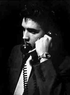 Elvis on phone with his mother , here in march 17 1956 in New-York.