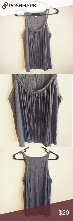 "Blue Rain Fringe Top by Francesca's Beautiful gray fringe top by Blue Rain from Francesca's Collections. Size Medium. Worn a couple of times; excellent condition. 95% Rayon, 5% Spandex. Length top to bottom: 23"", chest: 18"". Francesca's Collections Tops"