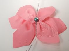 Learn how to make a very easy Mini Bowdabra Flower Bow. We use flower bows in our cardmaking, scrapbooking, home decor, and as hair bow toppers. We love the flower bow, so much our Mini Bowdabra packaging has a flower bow used as an embellishment for a gift card.  To make the Mini Bowdabra …