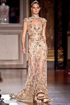 I have to admit...I WOULD like to have a place to wear such beautiful gown such as this....  Zuhair Murad Haute Couture. Love the hem of this dress.