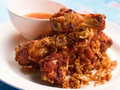 Thai Deep-Fried Chicken Recipe Main Dishes with garlic cloves, cilantro root, white peppercorns, flour, eggs, water, fish sauce, light soy sauce, chicken legs, oil, sweet chili sauce