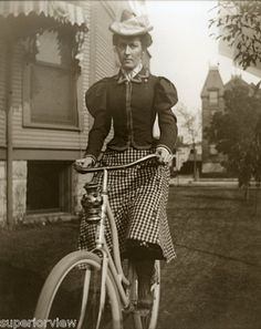 Antique Bicycle Woman Plaid Skirt Vintage Bike Lantern Hat with Feather 1897 | eBay -- This is a photograph made from the original 1897 glass negative. It shows a Chicago woman posing with her bicycle.