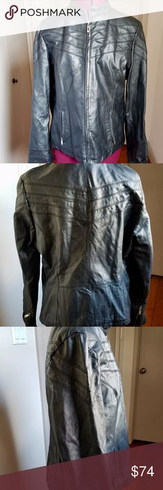 """Wilsons Leather Black Scuba Moto Motorcycle Jacket Wilsons Black Leather Women's Scuba Moto Jacket Black with zipper and stitching details pre-owned.  Size: Women's large. Measurements: Length (shoulder to bottom edge): 24.5  Chest (from under one arm to the other): 20"""". Waist, narrowest part: 18.5"""".  Sleeve: 23"""". Fully lined, light tan nylon body and striped interior sleeves. stitching detail on chest and shoulders 2 slit pockets on the front, Full zip.  zipper details on the cuffs of the…"""