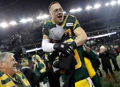 Edmonton Eskimos' JC Sherritt is hoisted in the air by teammate Willie Jefferson after the Eskimos defeated the Ottawa RedBlacks in the CFL's Grey Cup . Ottawa Redblacks, Grey Cup, Football, Sports, Jackets, Tops, Hs Football, Hs Sports, Soccer