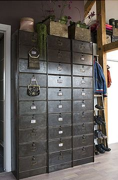 Perfect old card catalog for your closet, for all of your incidentals, I see the drawers are labelled....that would be a good thing with me!