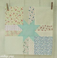 @ vintage grey: scrappy star - Sew Sweet Bee block - tutorial here: http://www.cloverandviolet.com/2011/11/12-days-of-christmas-sampler-quilt-along.html
