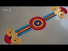 Very easy small and innovative rangoli design Easy Rangoli Designs Videos, Rangoli Designs Simple Diwali, Simple Rangoli Border Designs, Indian Rangoli Designs, Rangoli Designs Flower, Rangoli Borders, Free Hand Rangoli Design, Rangoli Patterns, Border Embroidery Designs