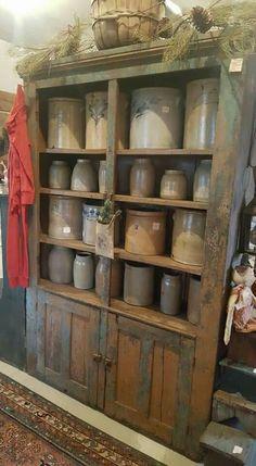 Love love love These crocks! Primitive Homes, Primitive Kitchen, Primitive Antiques, Country Primitive, Primitive Decor, Primitive Outdoor Decorating, Primitive Cabinets, Antique Crocks, Old Crocks