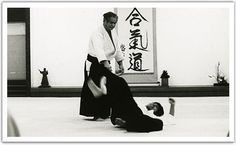 """Sadateru Arikawa Sensei at Aikikai Hombu Dojo:  Q: Do you remember the first time that you went to the dojo?  A: I remember. I went there after lunch, so nobody was there. When I called out """"Excuse me…"""" a person come out shouting """"What is it!?"""" in a frightening voice. When I said """"I'd like to become a student"""" they said """"Do you know what Aikido is?"""". Then when I said """"it's something like a cross between Karate and Judo"""" they got angry. (laughing) They made me sit in seiza at the side of the…"""