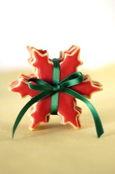 Pretty red snowflake cookies tied together with green satin ribbon!!! Bebe'!!! This makes a great stocking stuffer or is perfect for the cookie exchange!!!