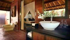 Maya Loka Villas  (  Bali, Indonesia  )  Indoor-outdoor bathrooms are expansive and have rain showers.