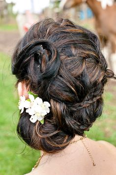 Another 25 Bridal Hairstyles & Wedding Updos | Confetti Daydreams - A side-swepted hairstyle combining twists and braids with a small floral accent to soften the look ♥