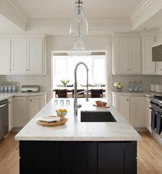 white kitchen, dark center island