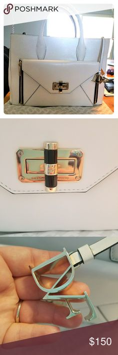 Pre-Loved DVF large white handbag Get this pre-loved leather handbag lightly used has minor stains which the pictures of that on the other posts in my closet. Also comes with straps  measurements  length: 12 1/2 inches height: 9 1/2 inches DVF Bags