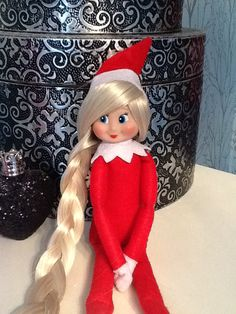 Our new Elf on the shelf with hair :-)    Remove hat glue gun wefts of hair extensions around the head then glue hat back on - simple!!! Or if you want wigs make hats then use same technique but glue hair to inside rim of hat, different hair for every day of the week.