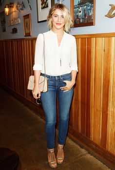 Julianne Hough in a white blouse, jeans, and tan heels