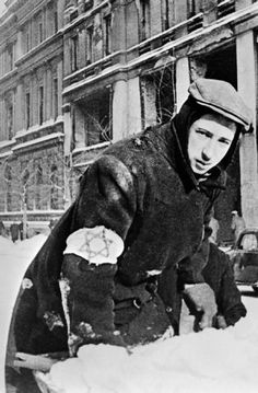 Antisemitism in Germany and the Occupied Territories: A Jewish citizen of Warsaw, forced to wear the 'Star of David', is employed on turning a public park into a Jewish cemetery during the winter of 1940.