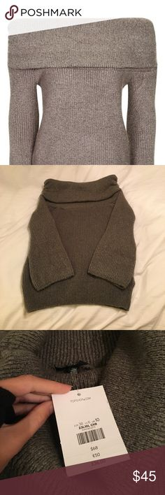 Gray Topshop Off the Shoulder Sweater New with tags! Gray Size 6 (small) off the shoulder from Topshop. The shoulders have ruched stitching to keep the sweater in place. Depending on height, could even be worn as a dress with leggings/tights. Extremely cozy and perfect for holidays! Topshop Sweaters