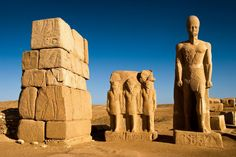 stones reused   Shoshenq III Pylon of the temple of Amun at Tanis. The statue on the right, Ramesses II, came from  Pi Ramses and reused in the new Tanita capital.