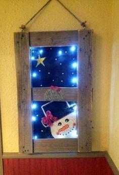 Glowing winter wood pallet window