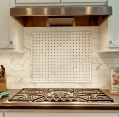 What Is The Backsplash Tile? Calcutta Gold? What Are The Small Squares?  Light