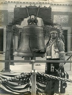 Chief Little Bear posed with the Liberty Bell in the Pennsylvania Building at the Panama Pacific International Exposition
