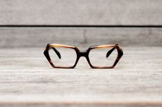 A little more expensive but so unique!!  stenzel eye glasses frame italy NOS // thick plastic tortoise. $146.00, via Etsy.