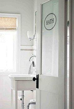 making a small bathroom feel bigger, bathroom ideas, home decor, small bathroom ideas, A custom half frosted door brings in light from the hallway