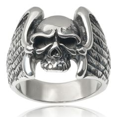 This eye-catching stainless steel ring by Vance Co. features a skull with eagle wings. Oxidized detailing adds depth to the design while a polished finish completes the look. Metal: Stainless steel Fi