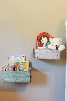 Old Wooden drawers hung on wall as shelves.