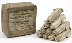 """CSA cartridge package with cartridges.  The package is labeled, """"10 CARTRIDGES / MISSISSIPPI OR AUSTRIAN RIFLE. / Calibre, .54. / CONICAL BALL / MACON ARSENAL / …APR[IL] 1864."""""""