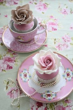 Pink teacup cupcakes. Out of budget (for the cups) but the idea makes me smile. I like the big roses on top of the fondant and white wrappers.