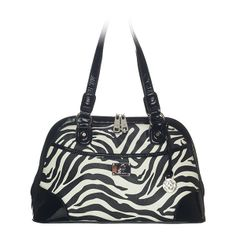 """Emma-Zebra Bag Posh and polished, the Emma shoulder bag makes a statement with a stamped ostrich pattern or sleek animal print and black patent faux leather trim.  •  Faux leather •  14"""" L, 9"""" H, 5"""" W •  Handles with 10"""" drop •  Exterior pocket fits any Grace Adele Clutch"""